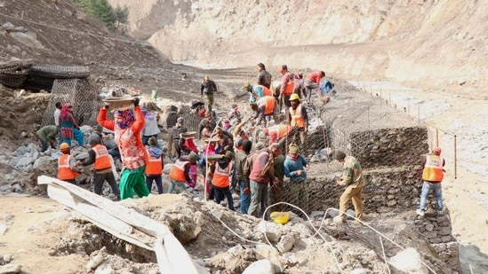 BRO workers engaged in building a valley bridge at Raini village, after Feb. 7 glacier burst, in Chamoli district of Uttarakhand.(PTI)