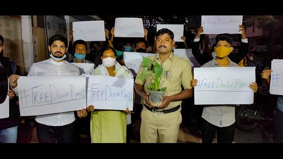 Friends and relatives of 21-year-old climate activist, Disha Ravi, Bengaluru, February 14, 2021 (PTI)
