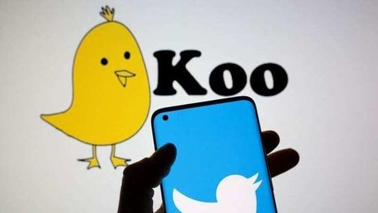 Twitter logo is seen on smartphone in front of displayed Koo app logo.(Reuters)