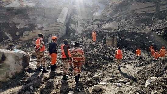 A team of ITBP, Police, and NDRF carrying out a search and rescue operation at Raini Village, in Chamoli on Monday. (ANI Photo)