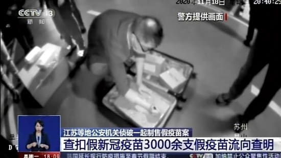 In this image taken from video footage run by China's CCTV, policemen seize fake Covid-19 vaccines in Kunshan in eastern China's Jiangsu Province, on November 18, 2020. (AP file)