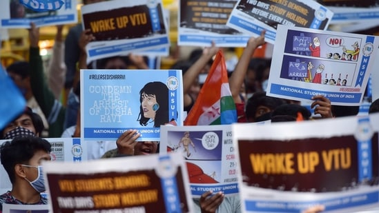 Bengaluru: Students and members of NSUI display placards during a protest to condemn the arrest of climate activist Disha Ravi and against the state government demanding the two days holiday before every exam, in Bengaluru, Tuesday, Feb. 16, 2021. (PTI Photo/Shailendra Bhojak)(PTI02_16_2021_000094B)(PTI)