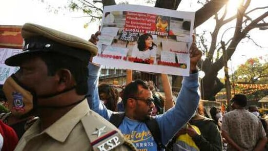 A man holds a placard demanding the release of Indian climate activist Disha Ravi, during a protest in Bengaluru, India, Monday, Feb.15, 2021. (AP)