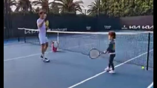 The video starts with a shot of a tennis court where Olympia and Mouratoglou can be seen playing tennis.(Instagram/@serenawilliams)
