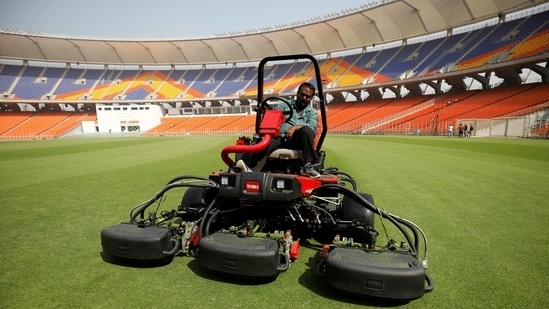 A groundsman works on the field at Sardar Patel Gujarat Stadium, where India and England are scheduled to play their third test match, in Ahmedabad, India, February 17, 2021. (REUTERS)