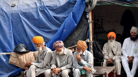 Farmers take rest during their ongoing protest against new farm laws at Singhu border, in Delhi on Tuesday (ANI).