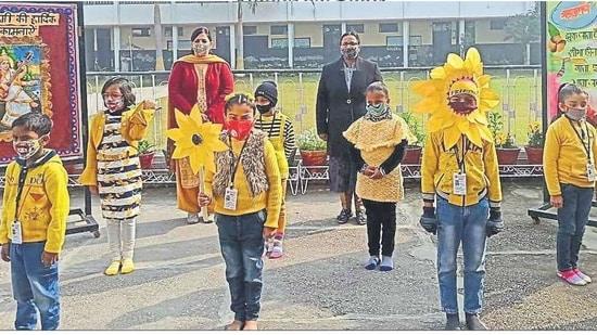 Children of Bhartiya Vidya Mandir School, Udham Singh Nagar, Ludhiana, taking part in Basant Panchami celebrations on campus..