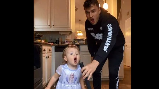 The image shows baby Marleigh singing with her uncle Chris .(Instagram/@theyeetbaby)