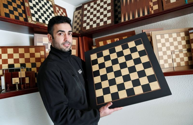 David Ferrer poses with a chessboard at the Rechapados Ferrer factory of which products have appeared in the Netflix series The Queens Gambit,(REUTERS)
