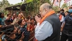 Union home minister Amit Shah interacts with people at Narayanpur village in South 24 Paraganas,(PTI)