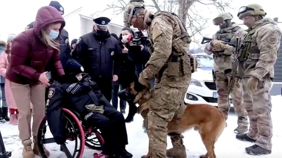 The image shows Oleksandr Andriychuk, who is terminally ill with brain cancer, during a ceremony organized by police in the town of Chernivtsi, Ukraine.(via REUTERS)