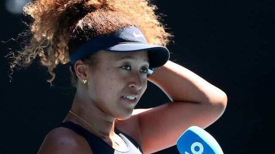 Tennis - Australian Open - Melbourne Park, Melbourne, Australia, February 18, 2021 Japan's Naomi Osaka is interviewed after winning her semi final match against Serena Williams of the U.S. REUTERS/Kelly Defina(REUTERS)