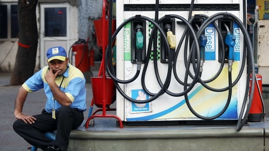 A petrol pump attendant waits for customers as national petrol and diesel prices rise at Bharat Petroleum Fuel Station, in New Delhi. (ANI File Photo )