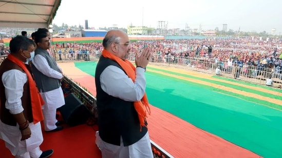 Union Home Minister Amit Shah waves during a public meeting to launch of fifth Poribortan Yatra in Kakdwip of South 24 Parganas district on Thursday. (ANI)