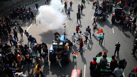 Police use tear gas to disperse farmers who marched to the capital during India's Republic Day celebrations in New Delhi, India on Jan.26, 2021. (AP)