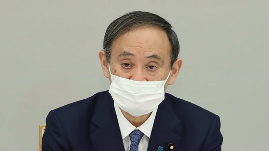 Governor Haruhiko Kuroda said he also told Prime Minister Yoshihide Suga that the global economy appeared to be picking up, based on estimates issued by the International Monetary Fund.(AFP)