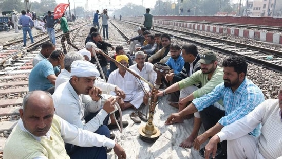 Farmers blocked rail tracks at Sonipat station in Haryana during their nationwide Rail Roko agitation on Thursday. (Ajay Aggarwal/HT PHOTO).