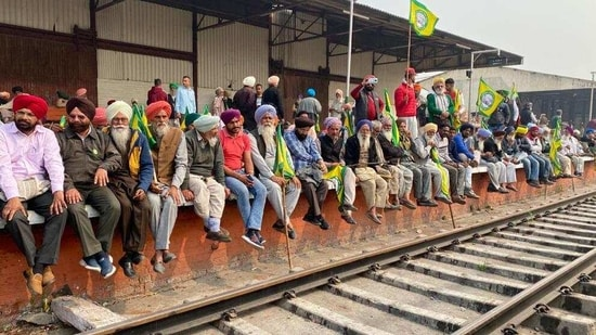 Farmers blocked rail track at Ludhiana railway station during their national wide Rail Roko protest on Thursday.(Gurpreet Singh/HT Photo )