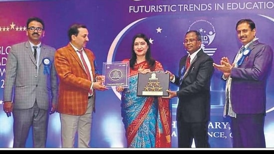 School principal Reema Tandon, centre, receiving the award from CBSE secretary Anurag Tripathi , second from left, during the 6th Edu-leaders Annual Conference which was held in Gurgaon
