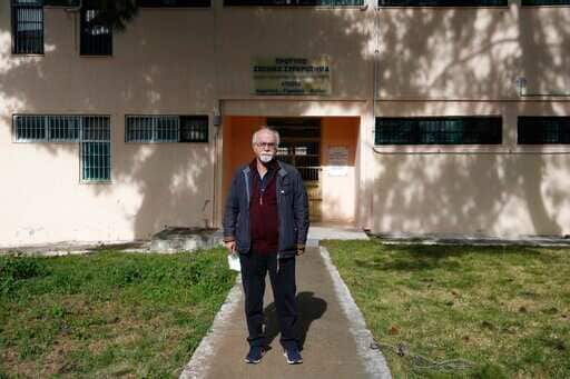 Prison school director Petros Damianos poses outside the building of Avlonas prison school, north of Athens.(AP)