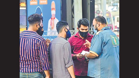 BMC officials fine citizens for violating Covid-19 norms at CSMT on Friday. (Bhushan Koyande/ HT)