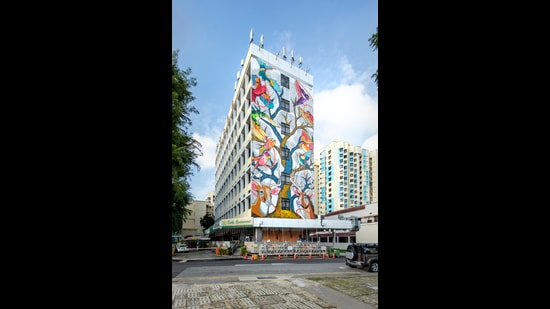 The work, painted on the facade of a hotel in Little India, represents the interconnectedness of India and Singapore, of Man and Nature, and the idea of art as healer. (Kevin Tan / St+art)