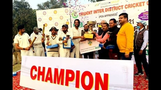 The Hoshiarpur District Cricket Association team after winning the Trident Inter-District One Day Cricket Tournament at Barnala on Thursday. (HT Photo)