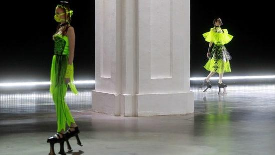 Models present creations by designer Polina Veller during Ukrainian Fashion Week in Kyiv, Ukraine February 7, 2021. (REUTERS)