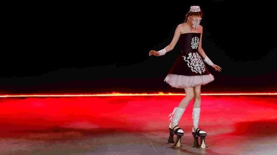 A model presents a creation by designer Polina Veller during Ukrainian Fashion Week in Kyiv, Ukraine February 7, 2021. (REUTERS)