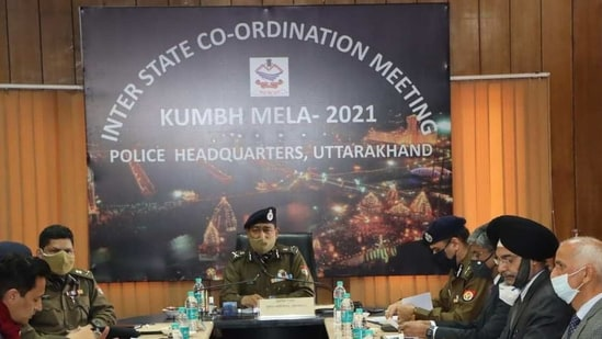 DGP Ashok Kumar (centre) chairing the inter-state coordination meeting for Mahakumbh on Friday evening. (HT Photo)