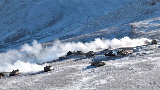 In this photograph provided by the Indian Army, tanks pull back from the banks of Pangong Tso lake region, in Ladakh along the India-China border on Wednesday, Feb. 10, 2021.(AP)