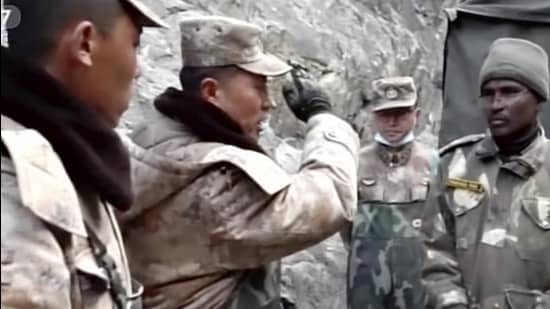 In this image taken from video footage run on February 19, 2021 by China's CCTV via AP Video, PLA regimental commander Qi Fabao (left) talks with members of the Indian military as Indian and Chinese troops face off in the Galwan Valley on the disputed border between China and India, on June 15, 2020. (AP)