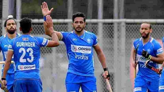Harmanpreet Singh (C) celebrates with teammates after scoring a goal against Spain in the India-Spain hockey test series match in Antwerp.(PTI)