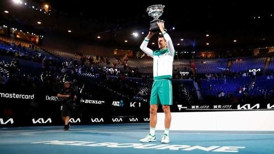 Tennis - Australian Open - Men's Singles Final - Melbourne Park, Melbourne, Australia, February 21, 2021 Serbia's Novak Djokovic celebrates with the trophy after winning his final match against Russia's Daniil Medvedev REUTERS/Asanka Brendon Ratnayake(REUTERS)