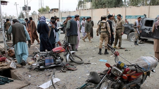 Helmand: Security personnel inspect the site of a deadly roadside bomb explosion in Helmand province, southern Afghanistan, Sunday, Feb. 21, 2021. Two separate roadside bomb explosions in Afghanistan on Sunday killed and wounded numerous people. AP/PTI(AP02_21_2021_000191A)(AP)