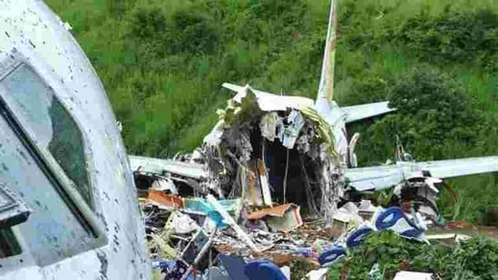 A security official inspects the site where a passenger plane crashed when it overshot the runway at the Calicut International Airport in Karipur, Kerala on August 8, 2020.(Reuters Photo)