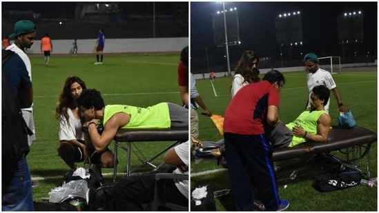 Disha Patani is seen next to Tiger Shroff as he got checked on after hurting his leg on the football field.