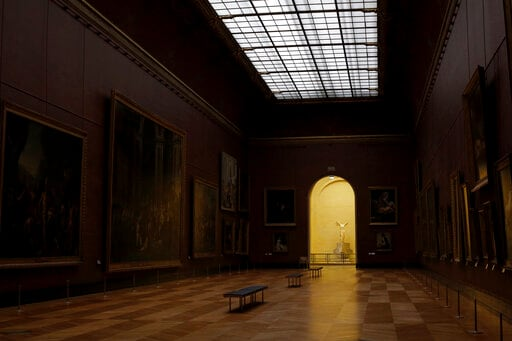 The sculpture The Victory of Samothrace is seen in a deserted Louvre museum, in Paris.(AP)