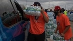 Volunteers deliver water to local residents in vehicles at Butler Stadium after an unprecedented winter storm in Houston, Texas, US on February 21, 2021. (Reuters File Photo )