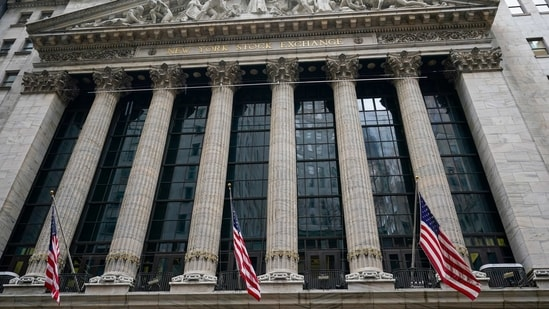 American flags hang outside of the New York Stock Exchange in New York. (AP)