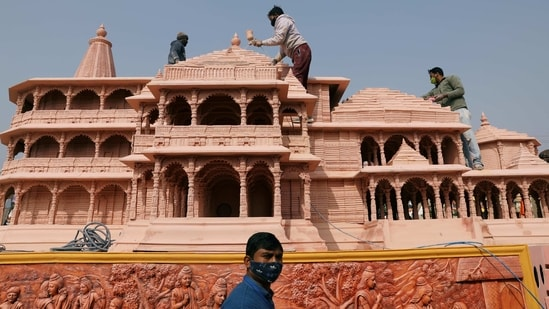 Workers give finishing touches to the model of the proposed Ram temple that Hindu groups want to build at a religious site in Ayodhya, on a tableau during a media preview of tableaux participating in the Republic Day parade in New Delhi, India January 22, 2021. (REUTERS)
