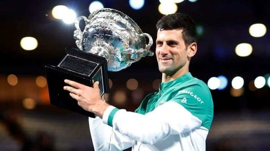 Serbia's Novak Djokovic celebrates with the trophy after winning his final match against Russia's Daniil Medvedev.(REUTERS)