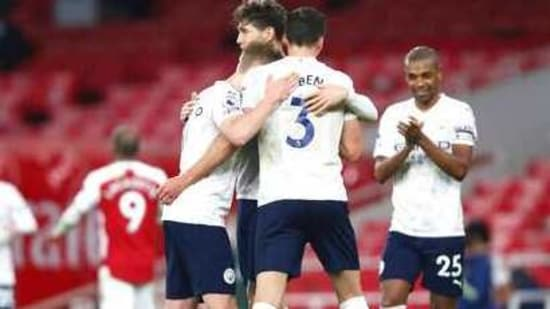 Manchester City players celebrate at the end of the English Premier League soccer match between Arsenal and Manchester City at the Emirates stadium in London.(AP)