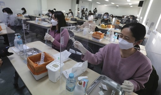 Medical workers attend a training to learn how to give coronavirus vaccine shots at the Korean Nurses Association in Seoul, South Korea. (AP Photo)