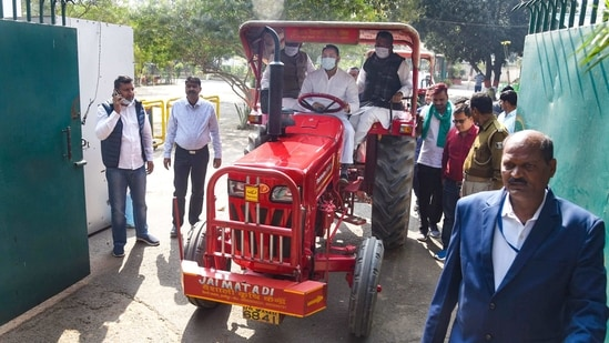 Patna: RJD leader Tejashwi Yadav rides a tractor during a protest against the new farm laws and fuel price rise amid the Budget Session of Bihar Assembly, in Patna, Monday,(PTI)
