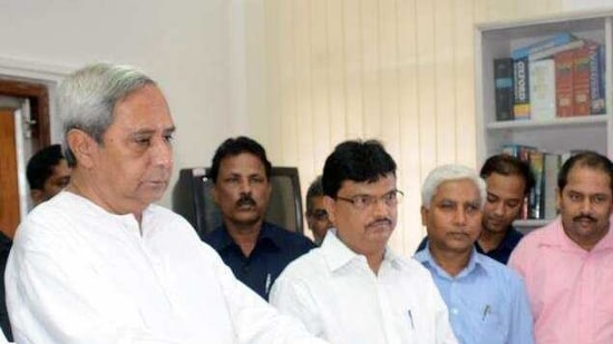 File photo: Odisha finance minister Niranjan Pujari along with chief minister Naveen Patnaik.(PTI)