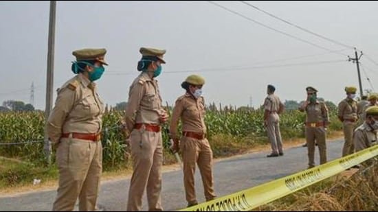 Police personnel stand guard as CBI officials (not in picture) investigate the case inHathras on October 13, 2020. (File photo)
