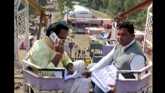 Minister Brijendra Singh Yadav said he is able to talk to officials after he reaches a particular height where mobile internet is available.(ANI)