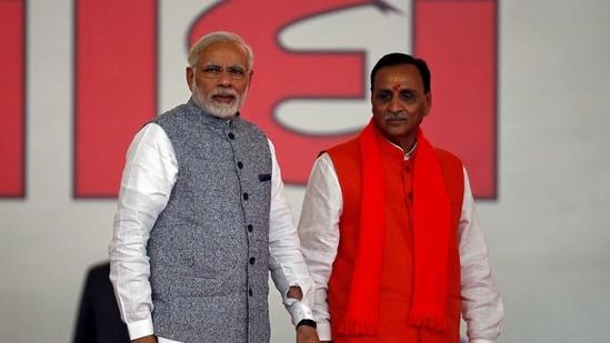 Vijay Rupani with Prime Minister Narendra Modi(Reuters)