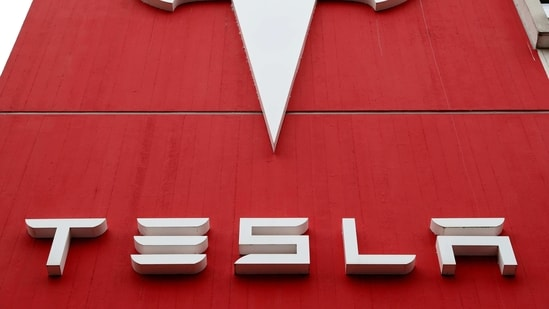 FILE PHOTO: FILE PHOTO: The logo of car manufacturer Tesla is seen at a branch office in Bern, Switzerland October 28, 2020. REUTERS/Arnd Wiegmann/File Photo/File Photo(REUTERS)